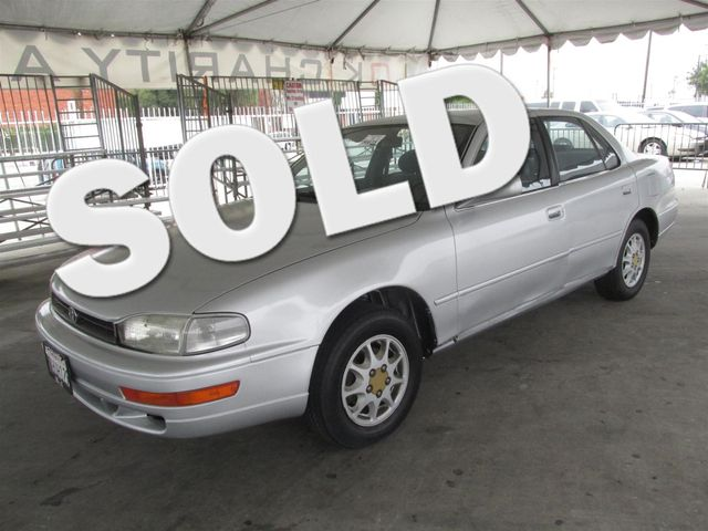 1993 Toyota Camry LE This particular vehicle has a SALVAGE title Please call or email to check av
