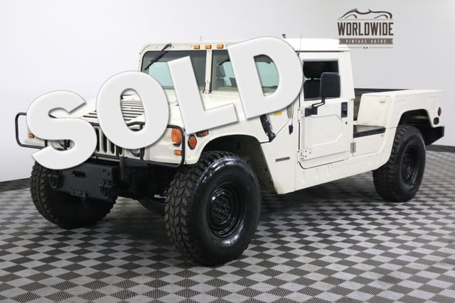 1995 Am General HUMMER H1 RARE TRUCK VERSION. LOW MILES. TIME CAPSULE | Denver, Colorado | Worldwide Vintage Autos