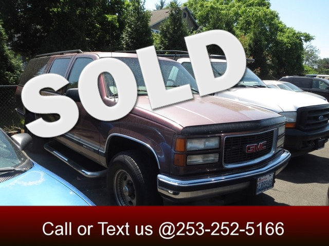 1997 GMC Suburban 4WD The CARFAX Buy Back Guarantee that comes with this vehicle means that you ca