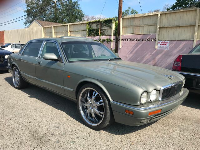 1997 Jaguar XJ L Limited warranty included to assure your worry-free purchase AutoCheck report is