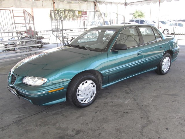 1997 Pontiac Grand Am SE Please call or e-mail to check availability All of our vehicles are av