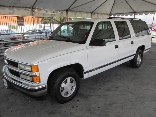 1999 Chevrolet Suburban This particular Vehicle comes with 3rd Row Seat Please call or e-mail to c