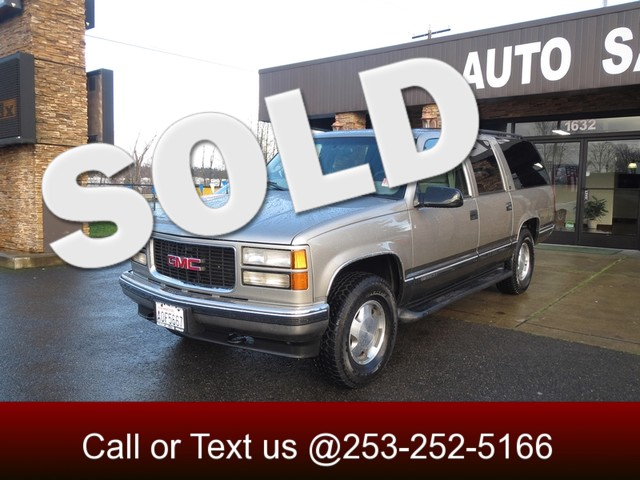 1999 GMC Suburban SLE 4WD This 99 Suburban continues the mission of taking six or more adults and
