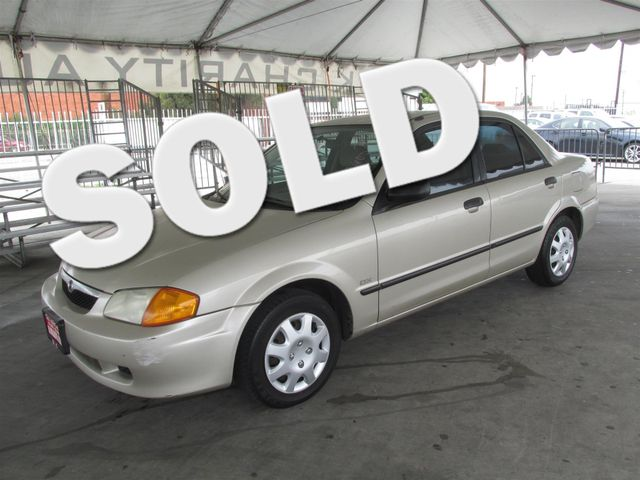 1999 Mazda Protege DX Please call or e-mail to check availability All of our vehicles are avail