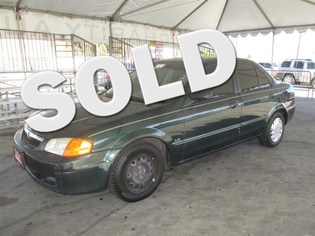 2000 Mazda Protege LX Please call or e-mail to check availability All of our vehicles are avail