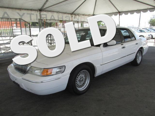 2000 Mercury Grand Marquis LS Please call or e-mail to check availability All of our vehicles a