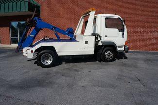 2000 Nissan UD 1400  wrecker Loganville, Georgia 10