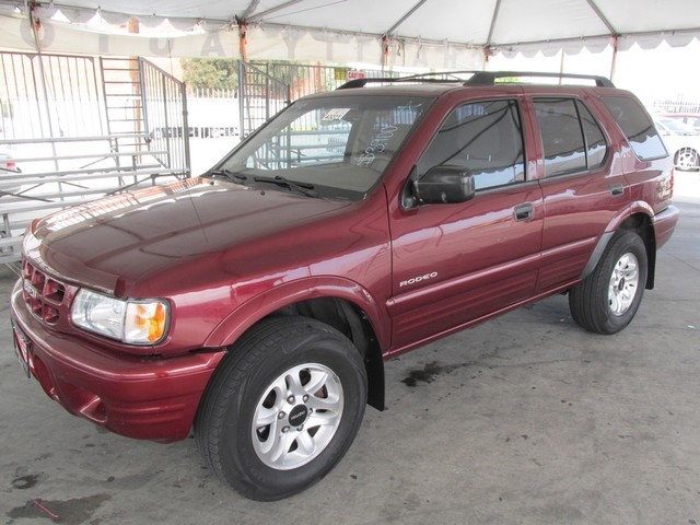2002 Isuzu Rodeo LS Please call or e-mail to check availability All of our vehicles are availabl