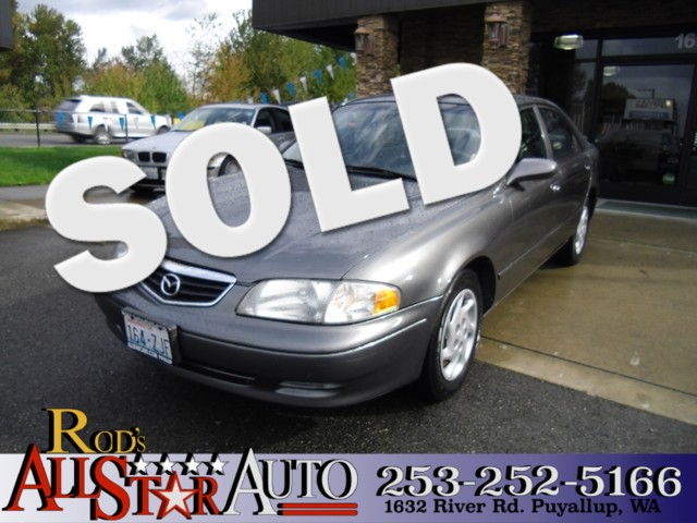 2002 Mazda 626 LX This clean 2002 Mazda 626 sedan is waiting for you to take it for a spin Youre