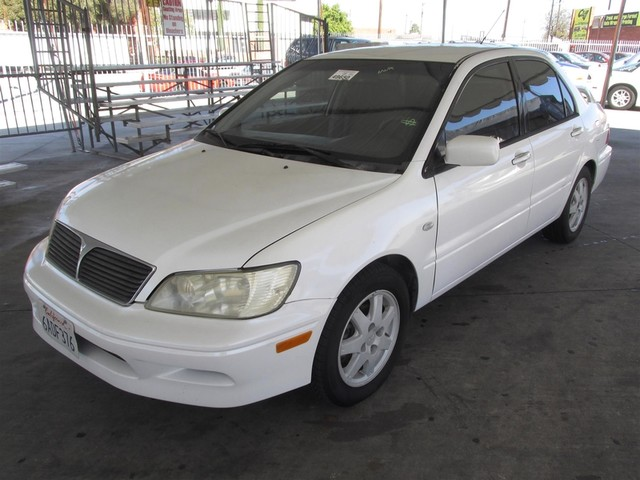 2002 Mitsubishi Lancer LS Please call or e-mail to check availability All of our vehicles are a