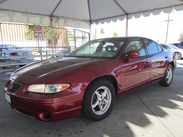 2002 Pontiac Grand Prix SE Please call or e-mail to check availability All of our vehicles are a