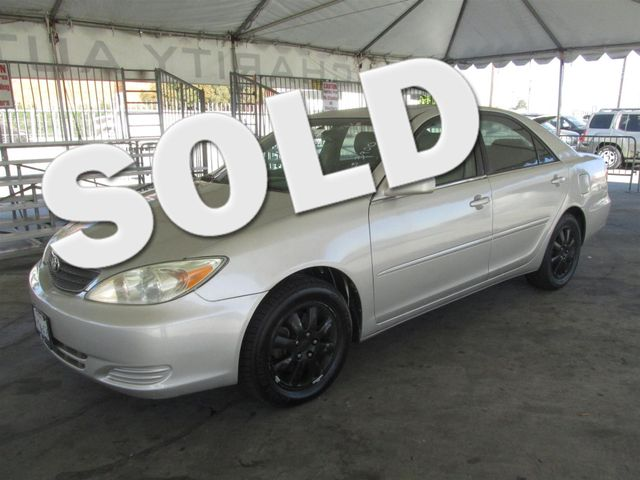 2002 Toyota Camry XLE This particular vehicle has a SALVAGE title Please call or email to check a