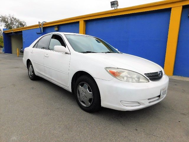 2002 Toyota Camry LE Limited warranty included to assure your worry-free purchase AutoCheck repor