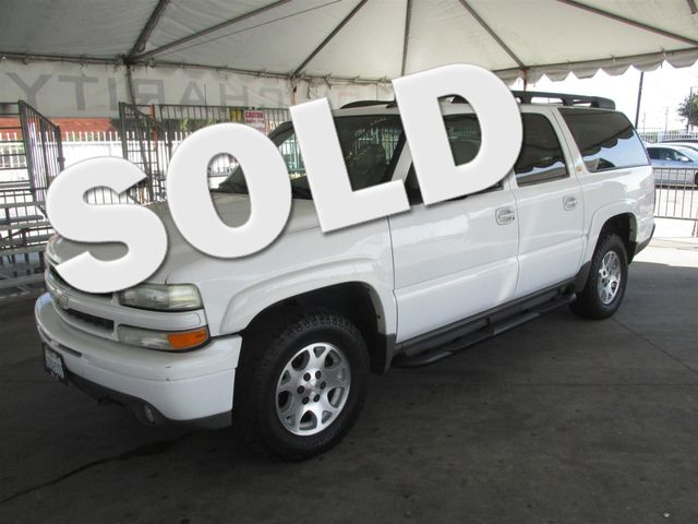 2003 Chevrolet Suburban Z71 This particular Vehicle comes with 3rd Row Seat Please call or e-mail