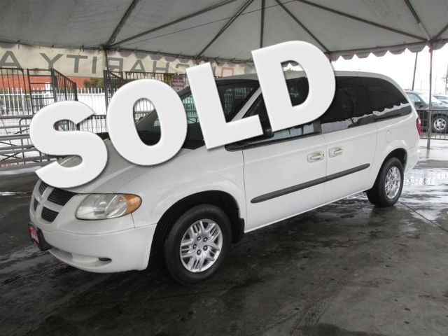 2003 Dodge Grand Caravan Sport This particular Vehicle comes with 3rd Row Seat Please call or e-m