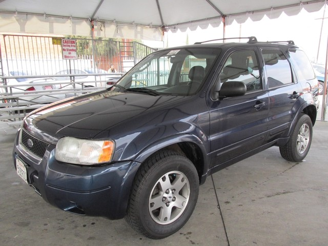 2003 Ford Escape Limited Please call or e-mail to check availability All of our vehicles are ava