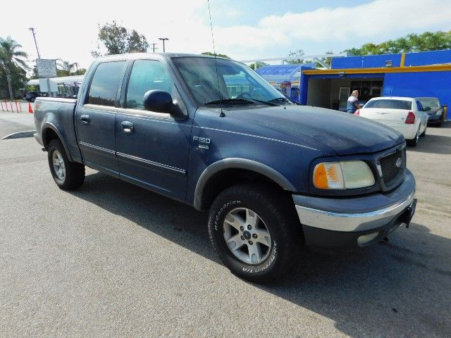 2003 Ford F-150 XLT Limited warranty included to assure your worry-free purchase AutoCheck report