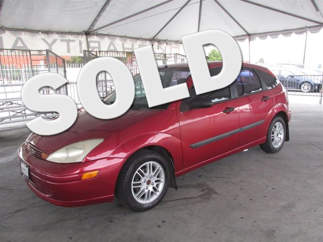 2003 Ford Focus ZX5 Base This particular vehicle has a SALVAGE title Please call or email to chec