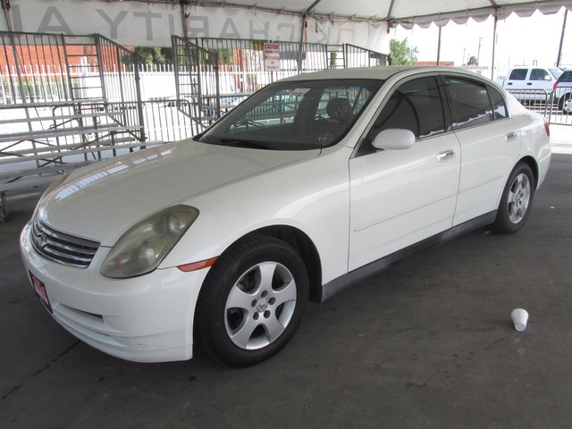 2003 INFINITI G35 This particular vehicle has a SALVAGE title Please call or email to check avail