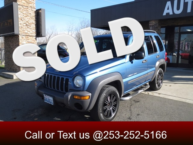 2003 Jeep Liberty Sport 4WD The CARFAX Buy Back Guarantee that comes with this vehicle means that