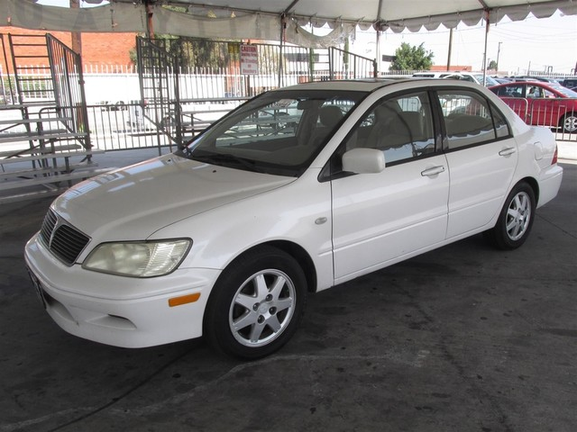 2003 Mitsubishi Lancer LS Please call or e-mail to check availability All of our vehicles are a