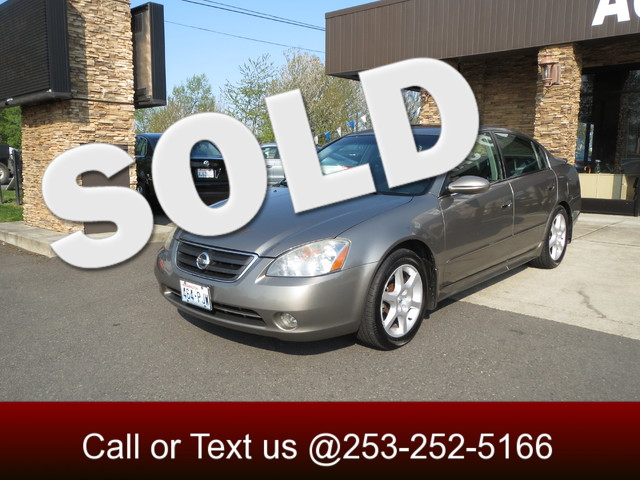 2003 Nissan Altima SE V6 The CARFAX Buy Back Guarantee that comes with this vehicle means that you