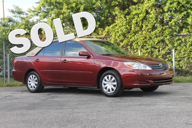 2003 Toyota Camry LE  WARRANTY CARFAX CERTIFIED FLORIDA VEHICLE TRADES WELCOME  The Toyo