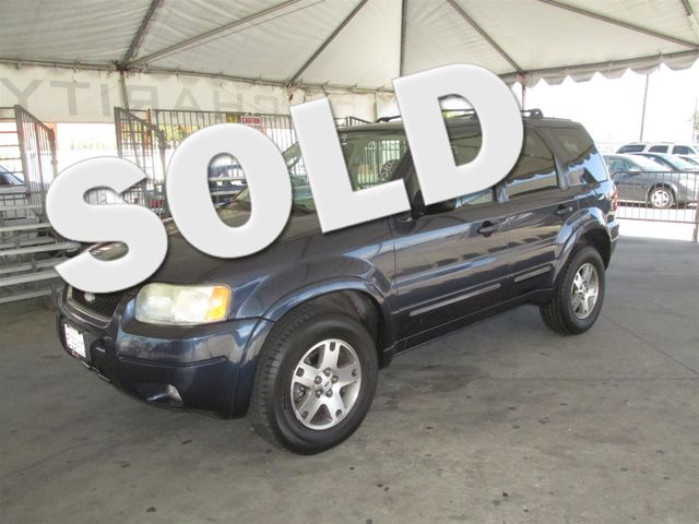 2004 Ford Escape Limited Please call or e-mail to check availability All of our vehicles are av