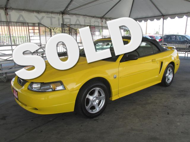 2004 Ford Mustang Deluxe Please call or e-mail to check availability All of our vehicles are av