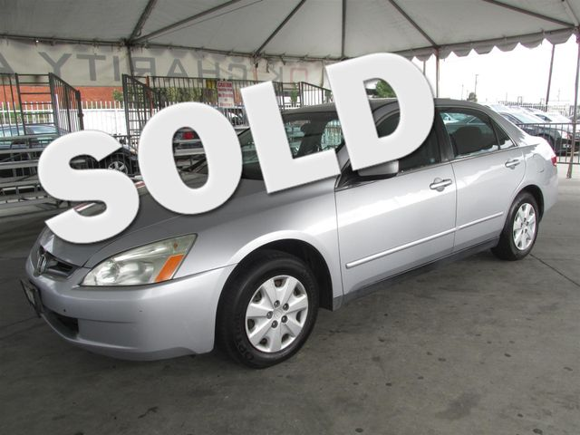 2004 Honda Accord LX This particular Vehicles true mileage is unknown TMU Please call or e-mai