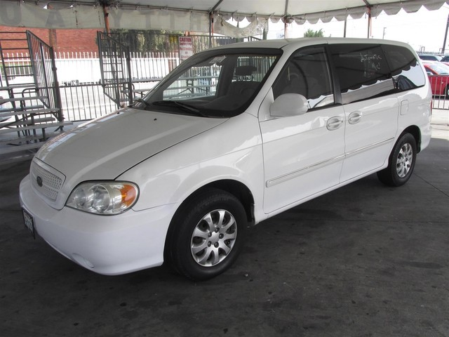 2004 Kia Sedona LX This particular vehicle has a SALVAGE title Please call or email to check avai