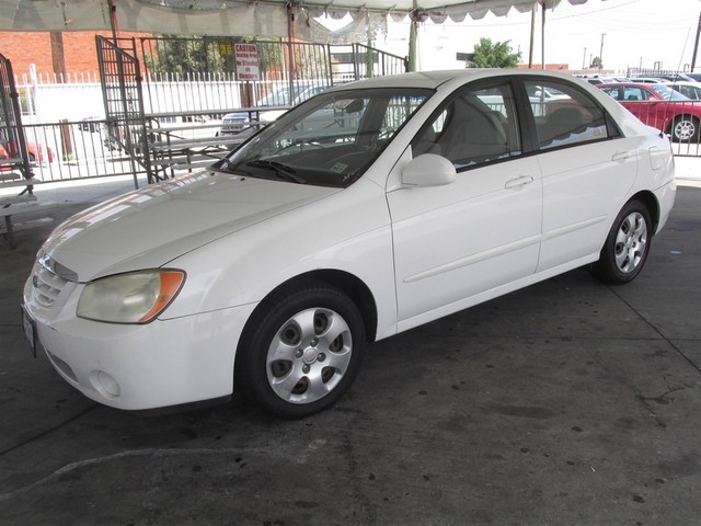 2004 Kia Spectra LX This particular vehicle has a SALVAGE title Please call or email to check ava