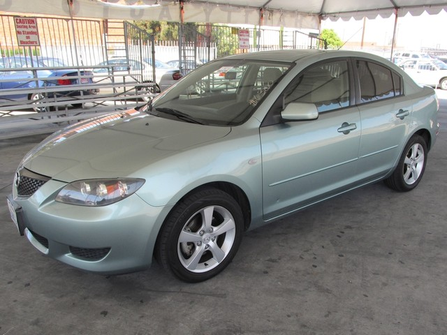 2004 Mazda Mazda3 i Please call or e-mail to check availability All of our vehicles are availabl