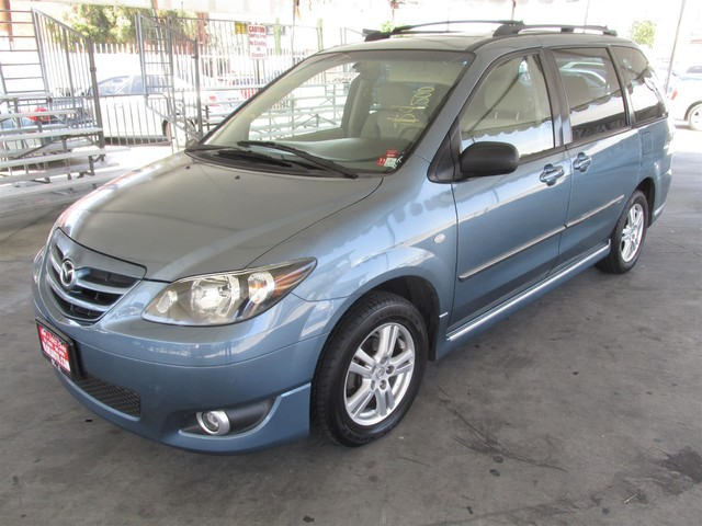 2004 Mazda MPV LX This particular Vehicle comes with 3rd Row Seat Please call or e-mail to check