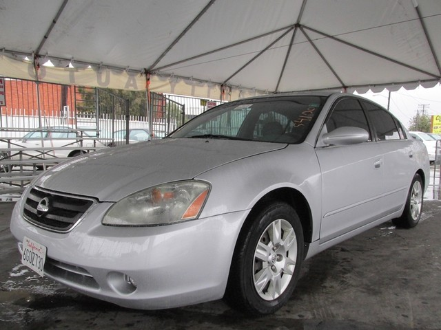 2004 Nissan Altima S This particular vehicle has a SALVAGE title Please call or email to check ava