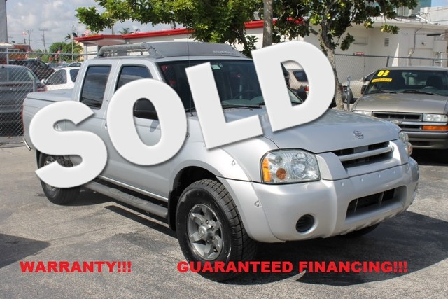 2004 Nissan Frontier XE  WARRANTY CARFAX CERTIFIED AUTOCHECK CERTIFIED 2 OWNERS FLORIDA VEH