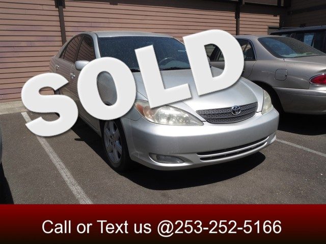 2004 Toyota Camry XLE The CARFAX Buy Back Guarantee that comes with this vehicle means that you ca