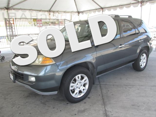 2006 Acura MDX Touring This particular Vehicle comes with 3rd Row Seat Please call or e-mail to c