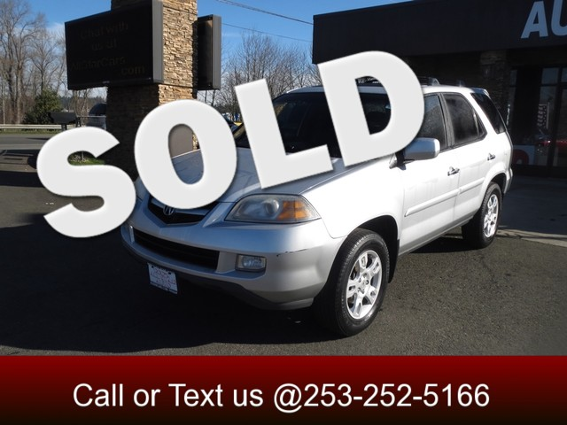2006 Acura MDX Touring AWD The CARFAX Buy Back Guarantee that comes with this vehicle means that y