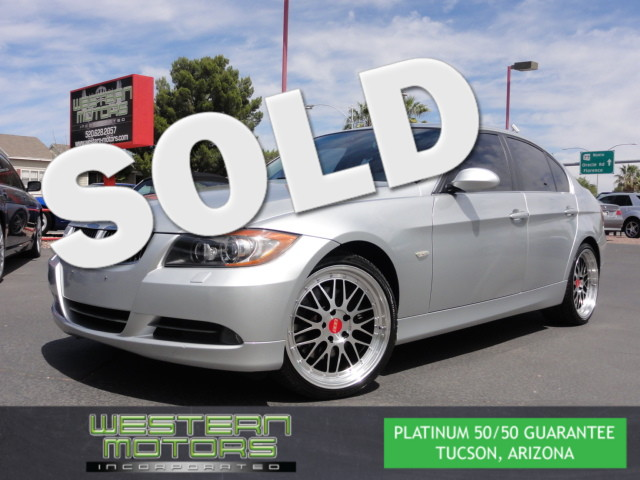 This 2006 BMW 330xi PREMIUM PKG is a Western Motors Featured Car