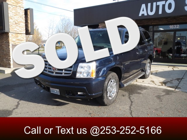 2006 Cadillac Escalade AWD The CARFAX Buy Back Guarantee that comes with this vehicle means that y