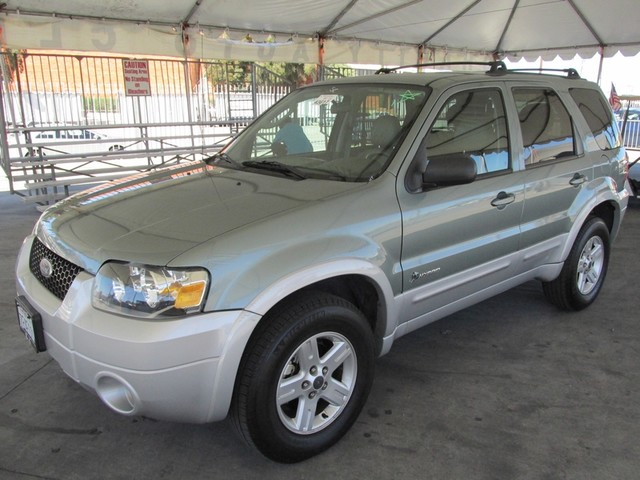 2006 Ford Escape Hybrid Please call or e-mail to check availability All of our vehicles are avai