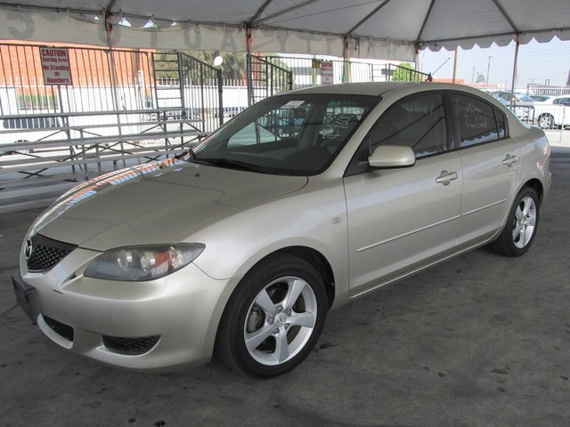 2006 Mazda Mazda3 i Touring Please call or e-mail to check availability All of our vehicles are