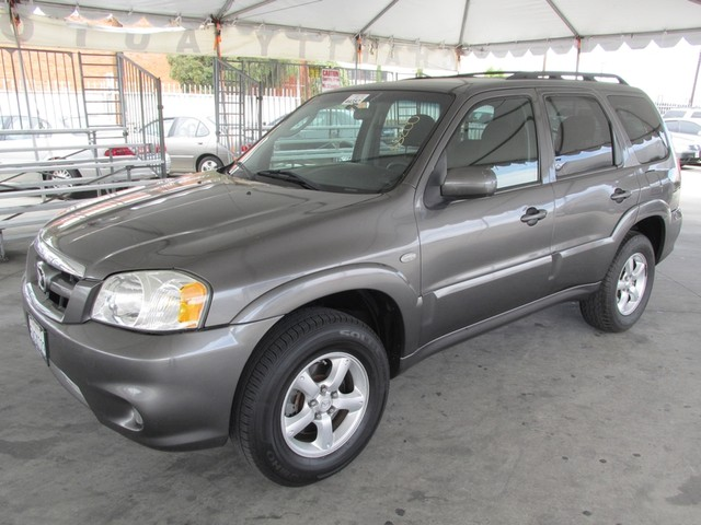 2006 Mazda Tribute s Please call or e-mail to check availability All of our vehicles are availa