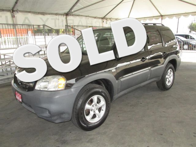 2006 Mazda Tribute i Please call or e-mail to check availability All of our vehicles are availa