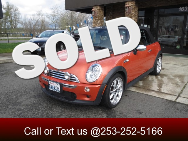 2006 MINI Convertible S Its a hot orange Mini convertible And you know you want to have one Ins