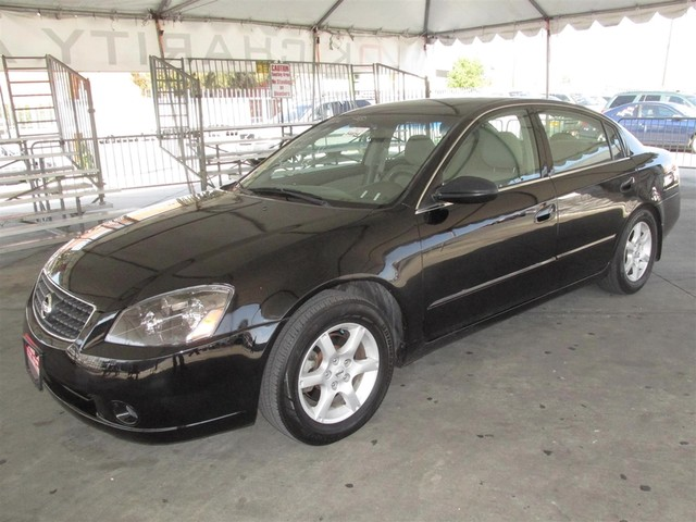 2006 Nissan Altima 25 S This particular vehicle has a SALVAGE title Please call or email to chec
