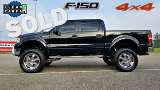 2007 Ford F150 LIFTED 4X4 CLEAN CARFAX SUPERCREW TOYO TIRES 150 TRUCK | Palmetto, FL | EA Motorsports in Palmetto FL