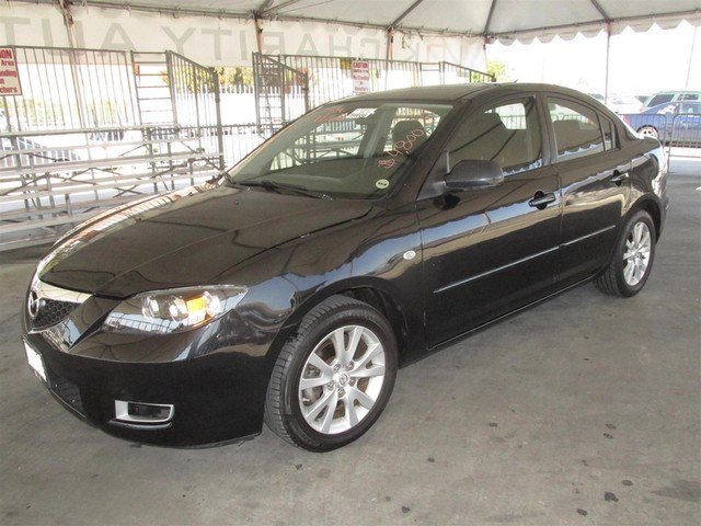 2007 Mazda Mazda3 i Touring Please call or e-mail to check availability All of our vehicles are