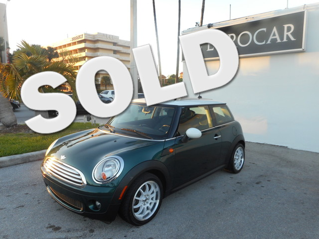 2007 MINI Hardtop Base 1 rear cup holder 4 cargo tie-downs in luggage compartment 12V auxiliary